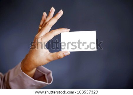 Hand holding blank business card - stock photo