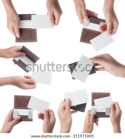 Hand holding blank business card with leather holder isolated on white background - stock photo