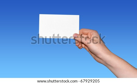 hand holding blank card with space for text