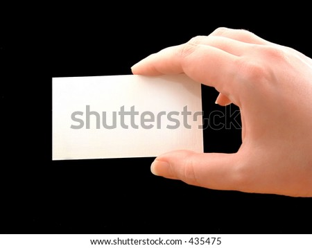 hand holding blank paper on black background - stock photo