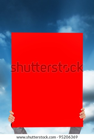 hand holding blank red Poster on blue sky background - stock photo
