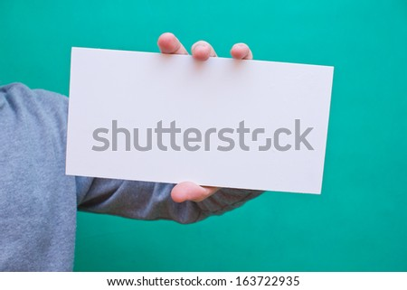 Hand holding blank white space desk advertising empty place - stock photo
