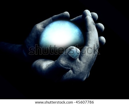 Hand holding blue crystal ball - stock photo