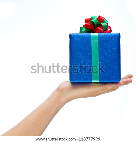 Hand holding blue present isolated on white background - stock photo
