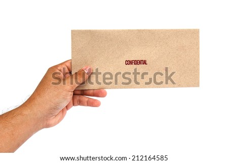 Hand holding Brown envelope with confidential stamp - stock photo