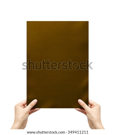 Hand holding brown leather Texture isolated on white - stock photo