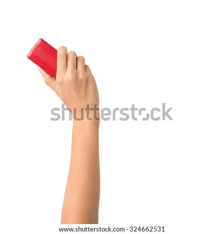 Hand holding brush erase isolated on white background - stock photo