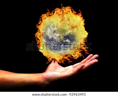 Hand holding burning earth(Earth view image from http://visibleearth.nasa.gov/ ) - stock photo