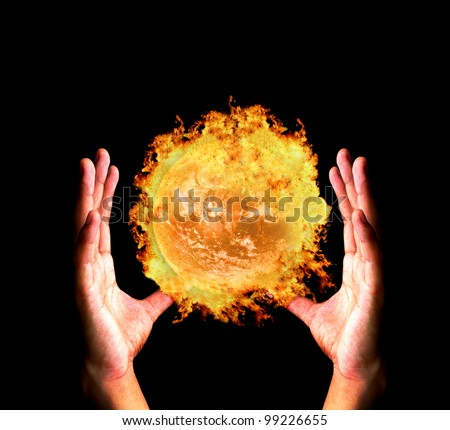 "Hand holding burning earth ""Elements of this image furnished by NASA"" - stock photo"