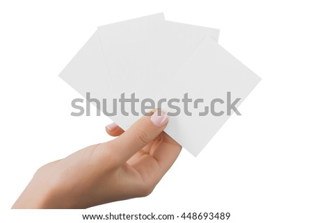 Hand holding business cards isolated at white background.