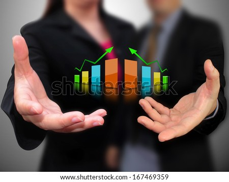 hand holding business graph  - stock photo