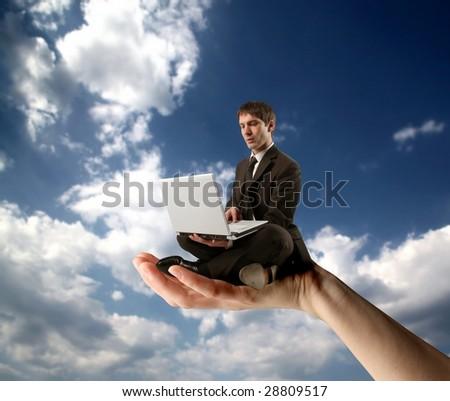 hand holding businessman using laptop - stock photo