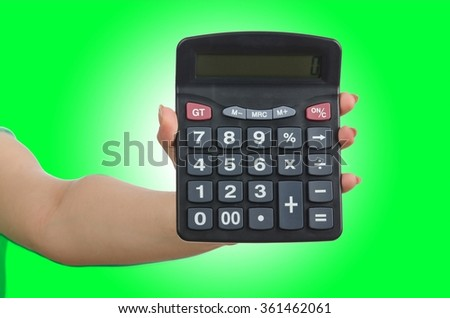 Hand holding calculator on white - stock photo
