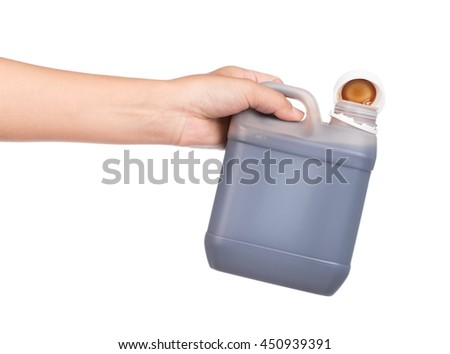 hand holding canister with machine oil isolated on white background - stock photo