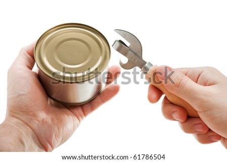 Hand holding canned preserved food metal can opener