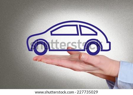 Hand holding car - stock photo