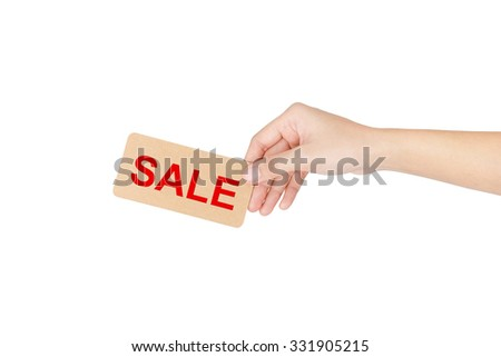 "Hand holding card with red word of ""Sale"" isolated on white with clipping path."