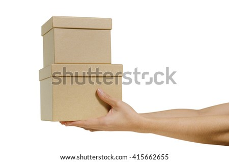 hand holding cardboard box isolated on a White background - stock photo