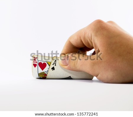 hand holding cards like in a poker game - stock photo