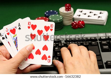 hand holding cards with computer keyboard chips and dices in background - stock photo