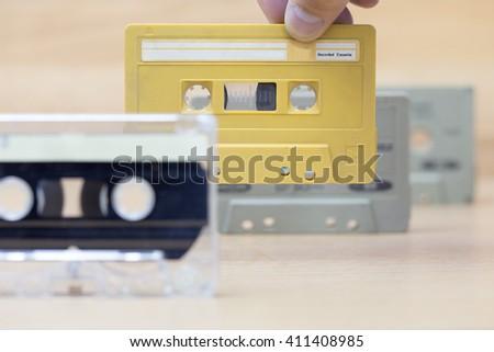 Hand holding cassette tape - stock photo