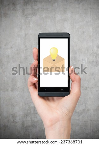 hand holding cellphone with email, close up - stock photo