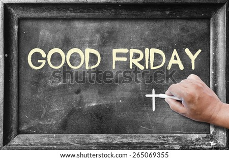 "Hand holding chalk and writing text ""Good Friday"" on blackboard. - stock photo"