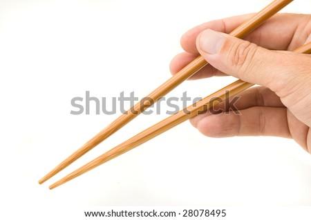 Hand holding chopsticks isolated on white background. - stock photo