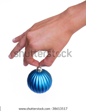 Hand holding Christmas ornament - stock photo