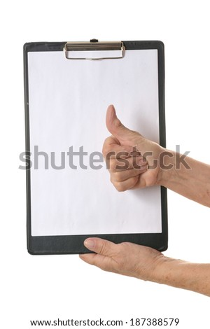 Hand holding clipboard with blank sheet of paper