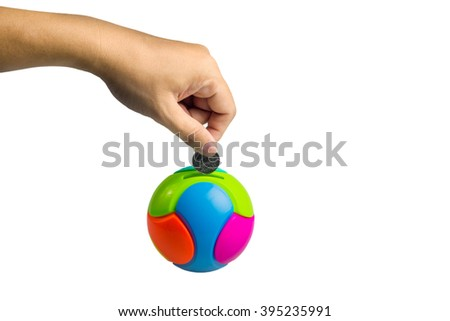 Hand holding coin 5 baht of Thailand drop it to colorful ball pi - stock photo