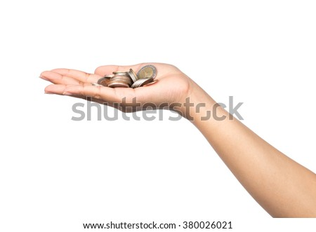 hand holding coin isolates on white background