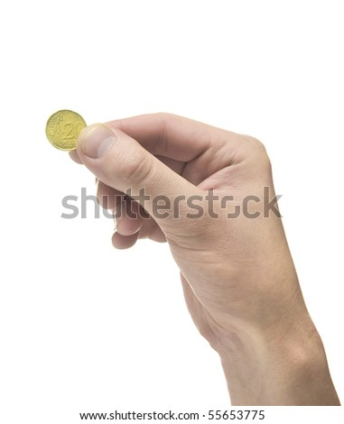 Hand holding coin on white background - stock photo