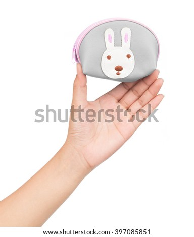 Hand holding coin purse Isolated on white background