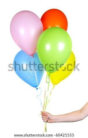 Hand holding colorful helium balloons isolated on white background - stock photo