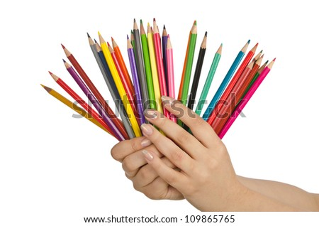 Hand holding colour pencils on white - stock photo