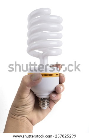 Hand holding compact spiral-shaped fluorescent lamp isolated on the white background - stock photo