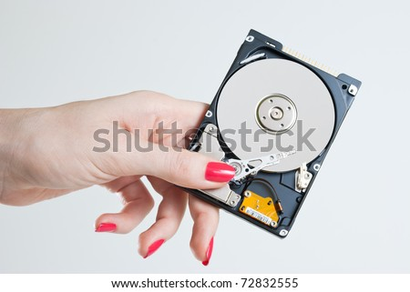 hand holding computer hard disk drive - stock photo