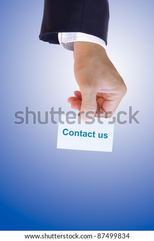 hand holding contact us card - stock photo