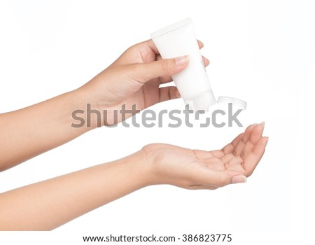 Hand holding Cosmetic plastic tube isolated on white background.
