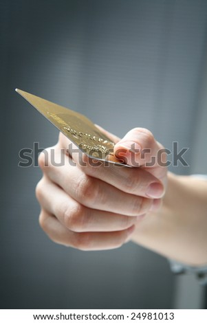 Hand holding credit card. - stock photo