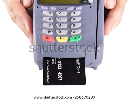 Hand Holding Credit Card Machine Isolated On White Background - stock photo