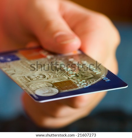 Hand holding credit cards. Small DOF. - stock photo