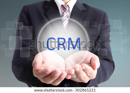 Hand holding CRM for go to good relationaship with customer - stock photo