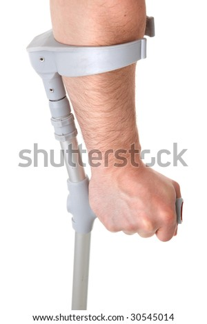 hand holding crutch on white background - stock photo