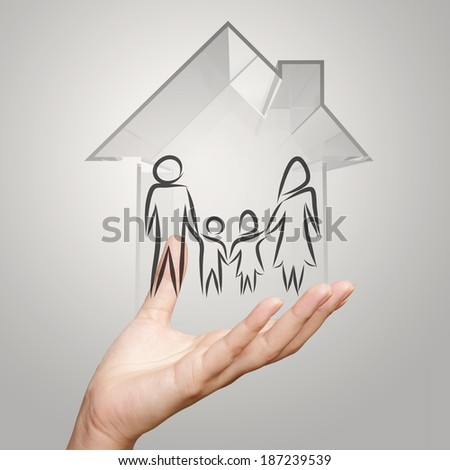 hand holding 3d house with family icon as insurance concept - stock photo