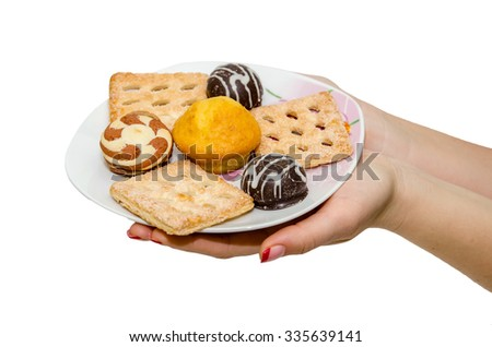 Hand holding delicious cake isolated on white background - stock photo