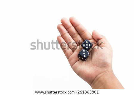 Hand holding dices isolated on white background - stock photo