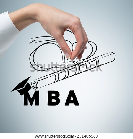 hand holding diploma of business academy - stock photo