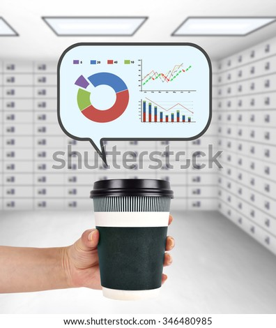 hand holding disposable coffee cup with stock chart - stock photo